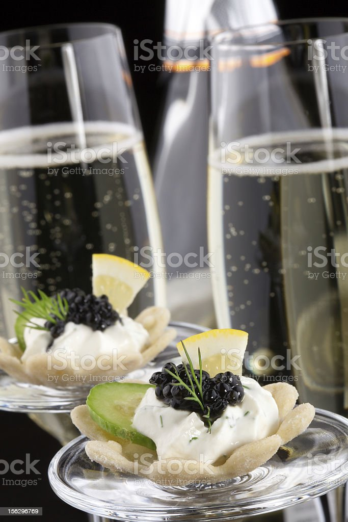 Black Caviar Canape and Champagne royalty-free stock photo