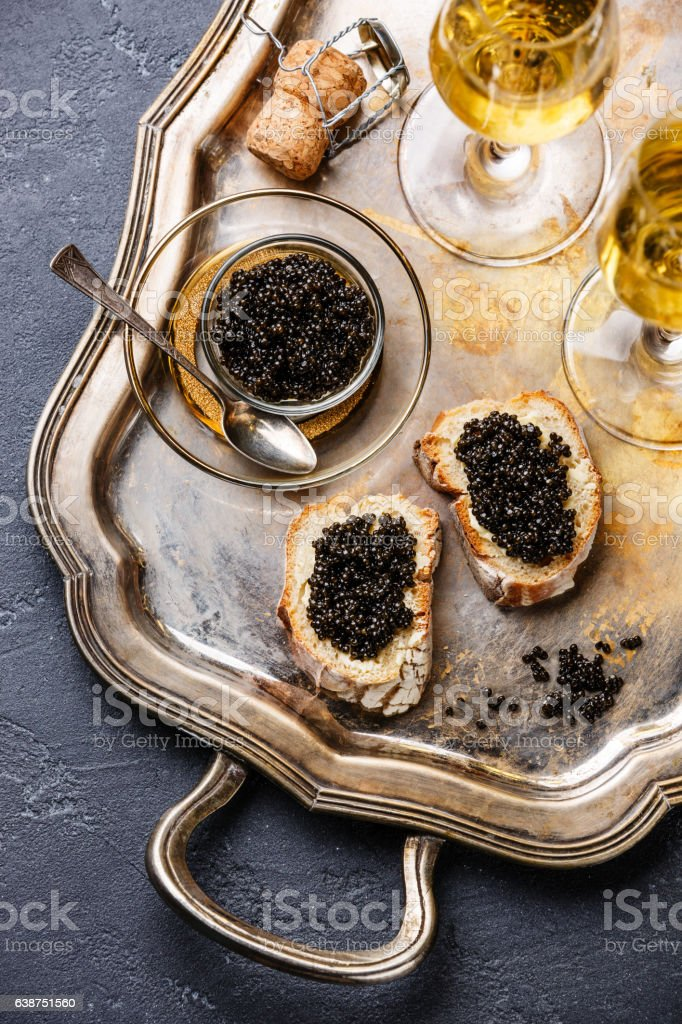 black caviar, sandwiches and champagne stock photo