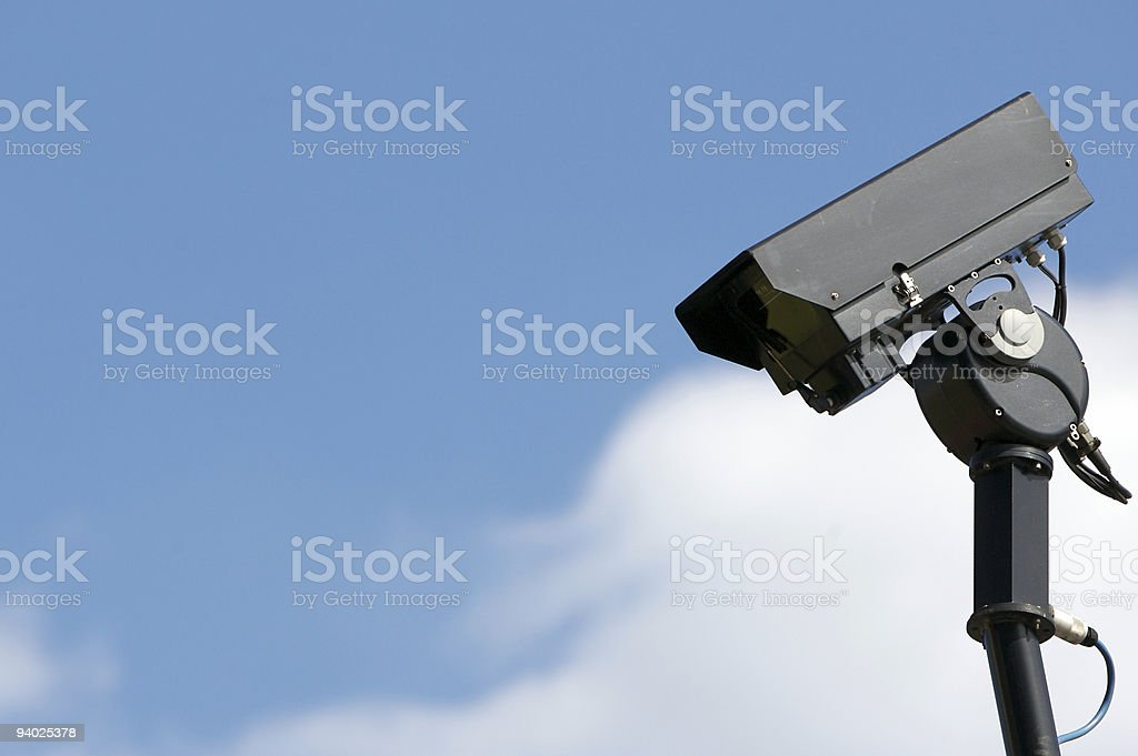 Black CCTV camera in evening sunshine royalty-free stock photo