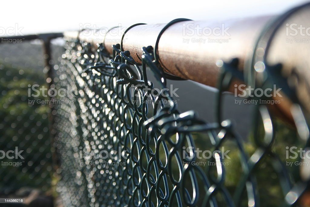 Black chain-link fence railing stock photo