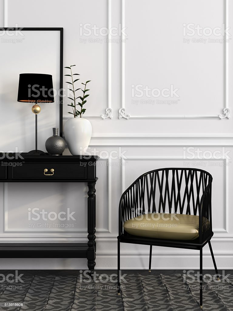 Black chair and table against a white wall stock photo