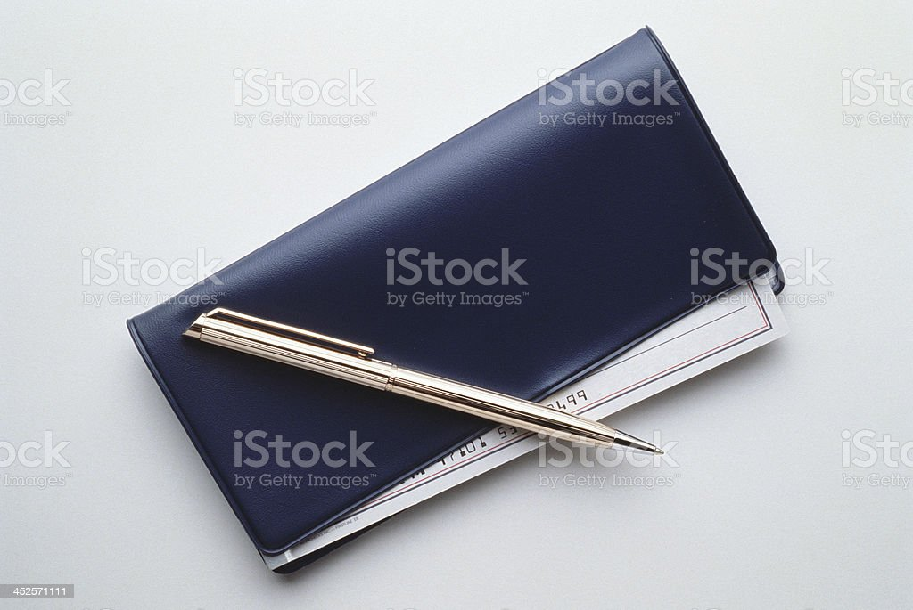Black checkbook with check and pen. stock photo