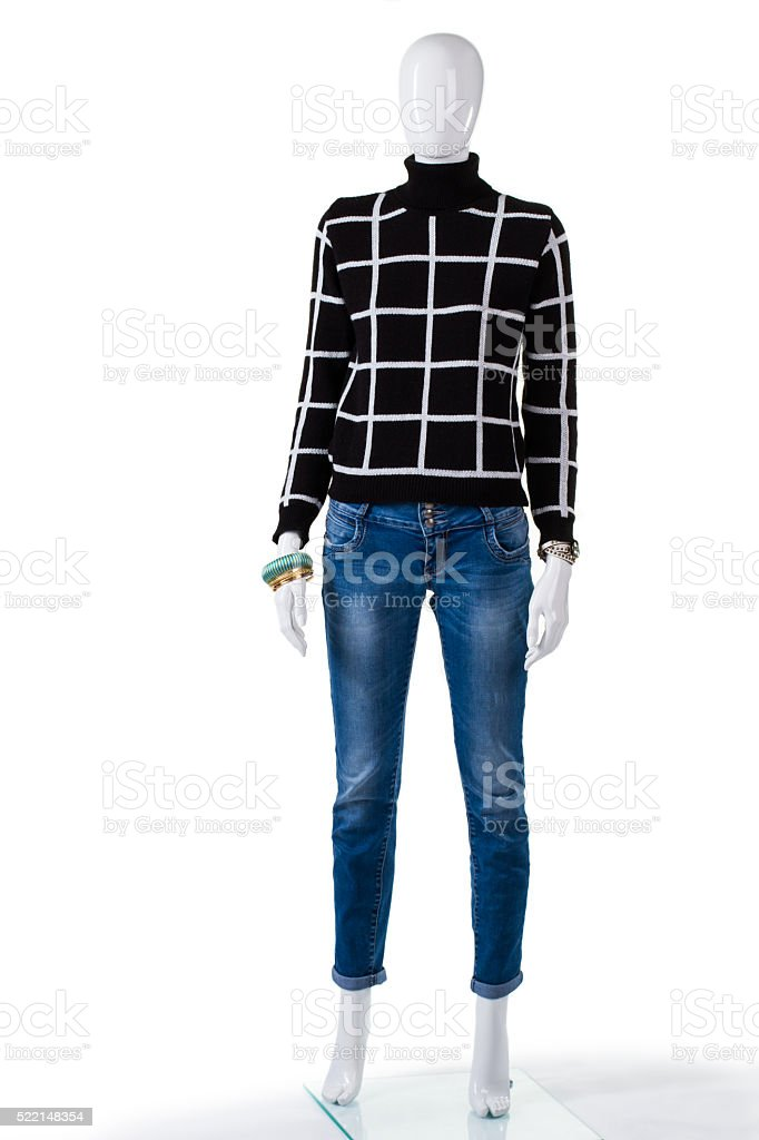 Black checkered pullover with jeans. stock photo