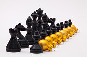 Black chess figure and golden Christmas decoration