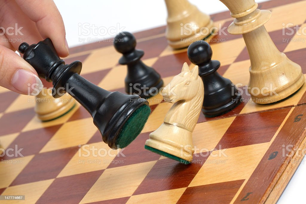 Black chess marker blow over the other stock photo