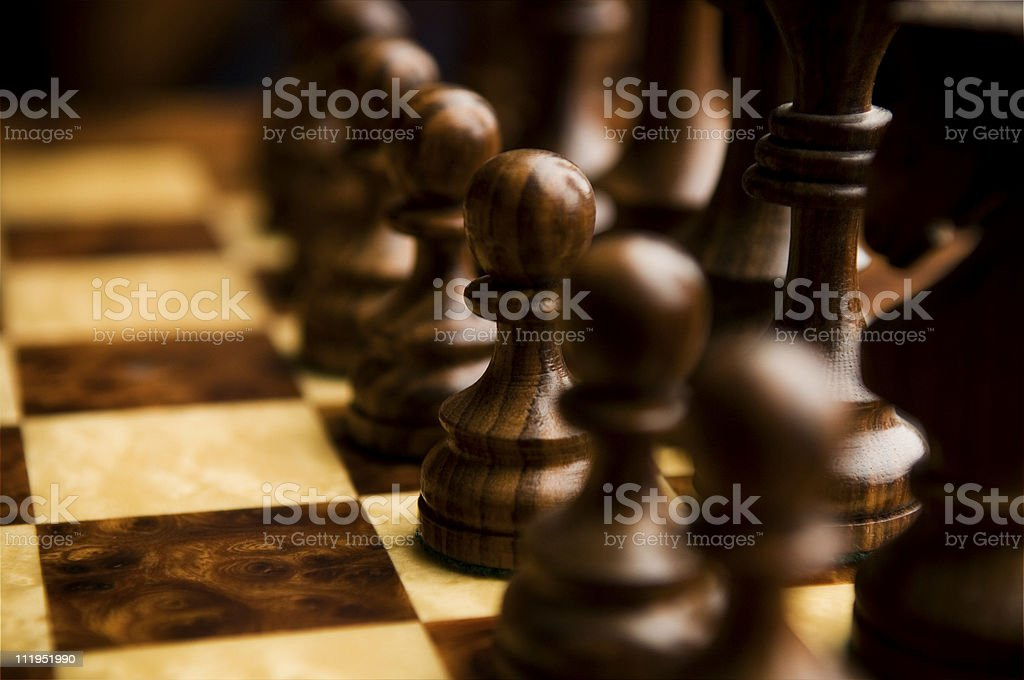 Black Chess Pawns in Line on Chessboard stock photo