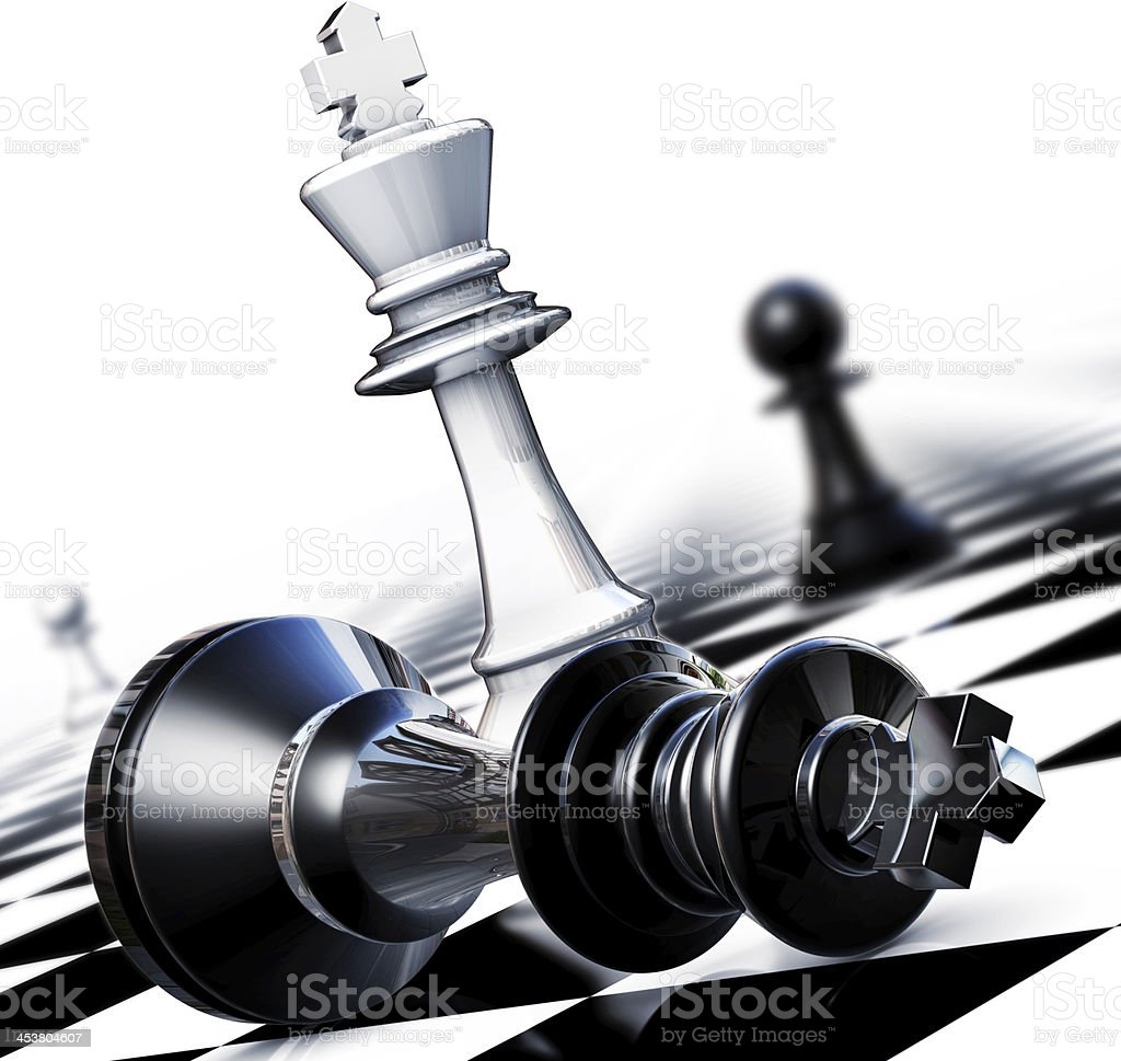 A black chess piece on its side on a checkered chess board stock photo