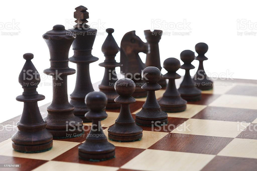 black chess pieces placed on chessboard royalty-free stock photo