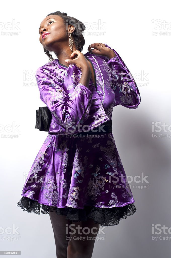 Black Chinese Female Model In A Purple Comona stock photo