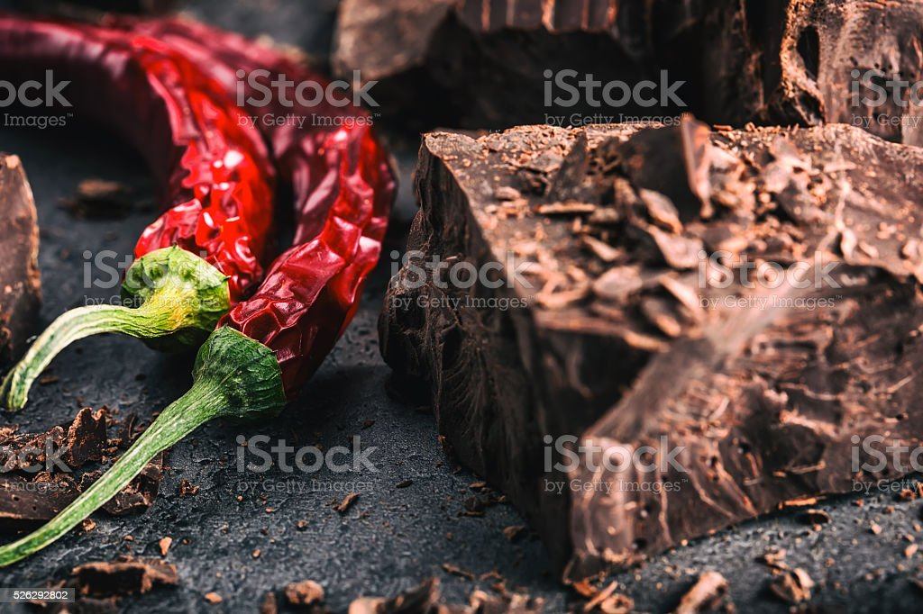 Black chocolate and chili pepper. Dark chocolate with chilli pepper. stock photo