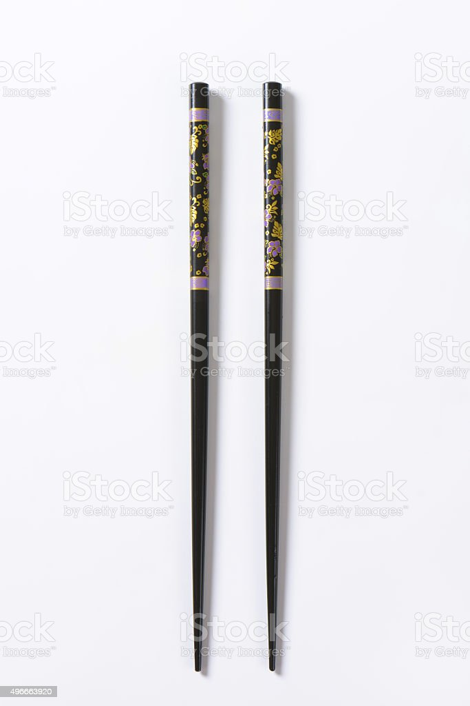 Black chopsticks with flower pattern stock photo
