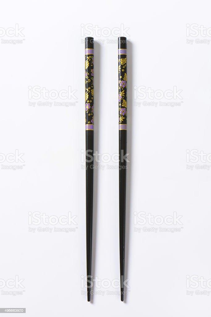 Black chopsticks with flower pattern stock photo