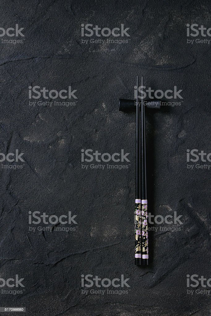 Black chopstics over textured surface stock photo