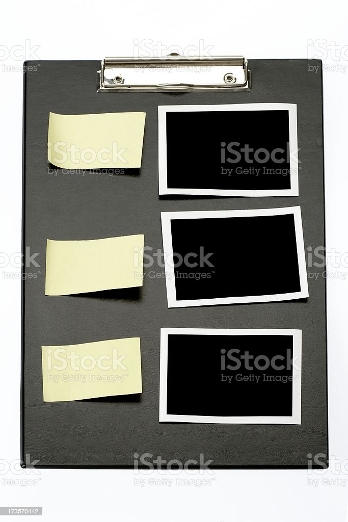 Black clipboard with 3 photo frames and postits stock photo