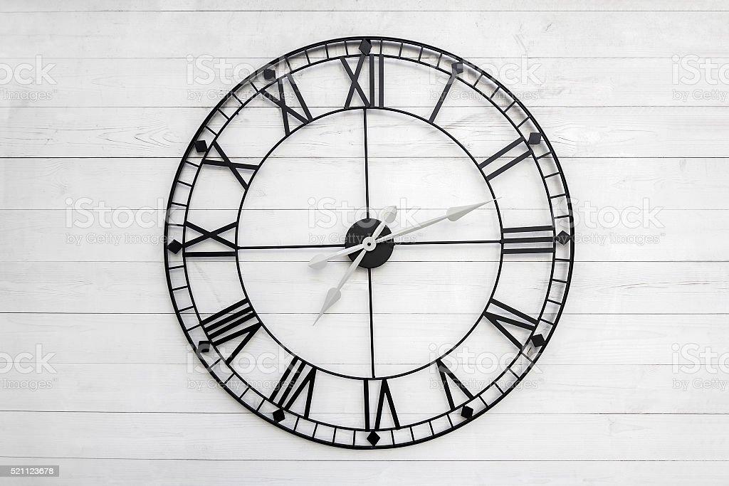 Black clock on white background stock photo