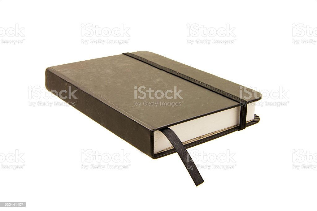 Black closed notebook isolated on white stock photo