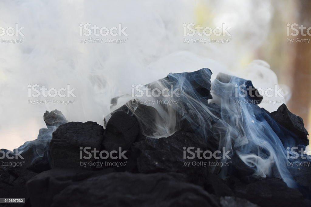 black Coal , white smoke stock photo