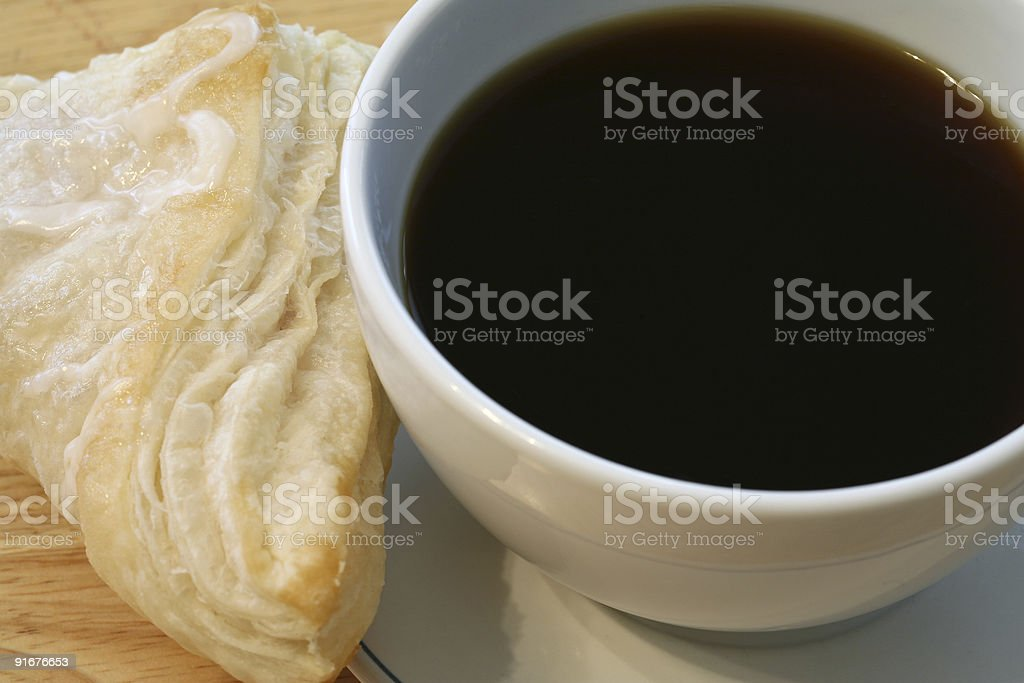 Black coffee and a turnover royalty-free stock photo