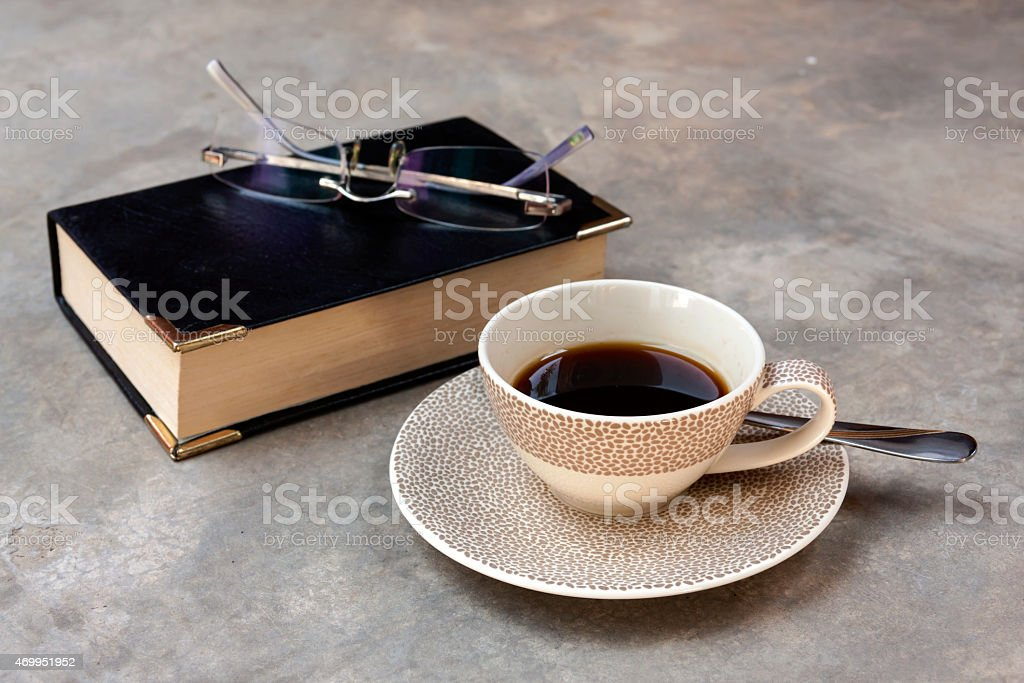 Black coffee and book with glasses royalty-free stock photo