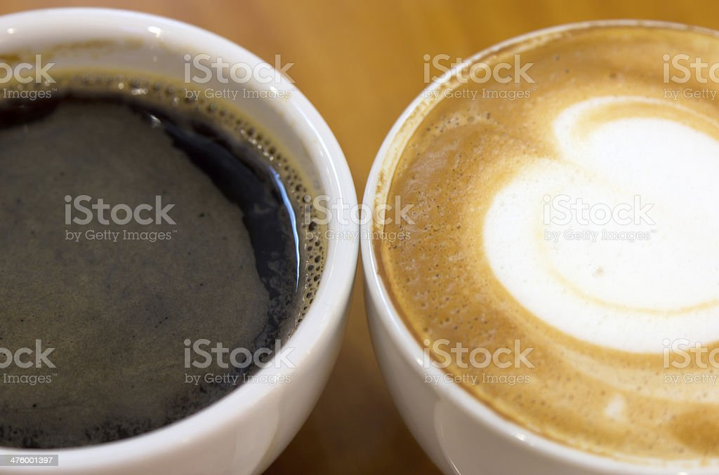 Black coffee and cappucino in the cup royalty-free stock photo