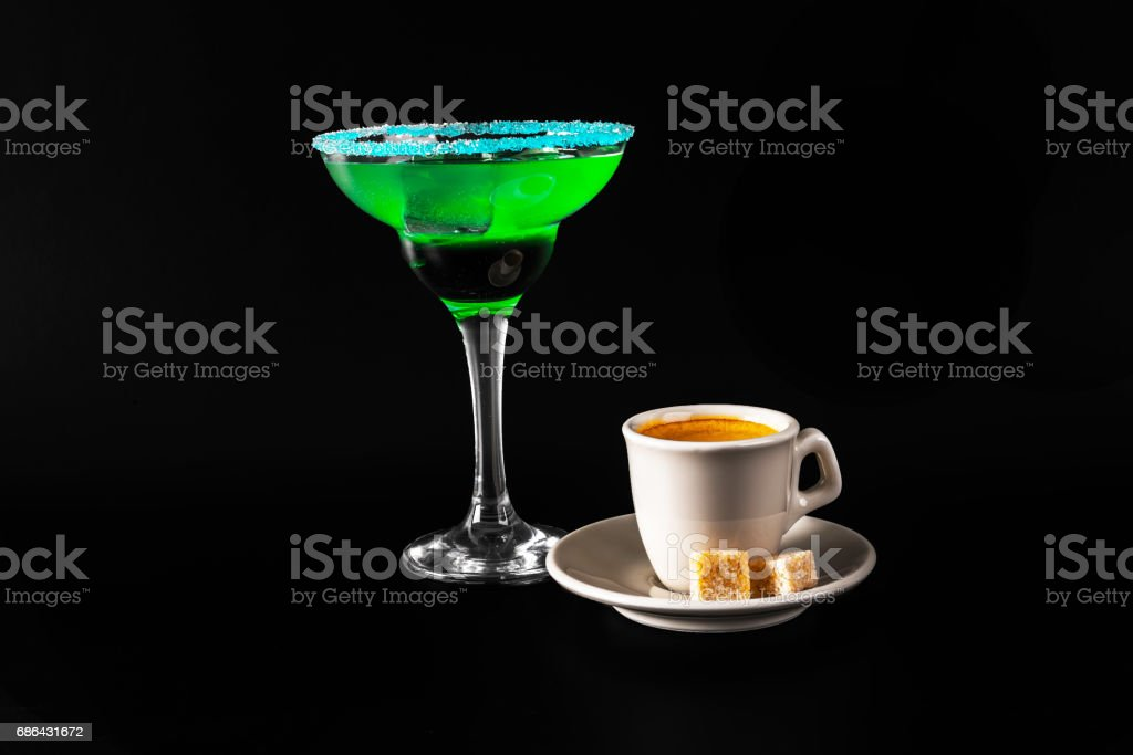 Black coffee and colorful drink in a cocktail glass, with ice cubes, summer drink stock photo