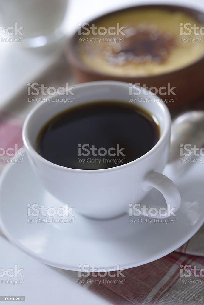 Black coffee and Crema catalana royalty-free stock photo