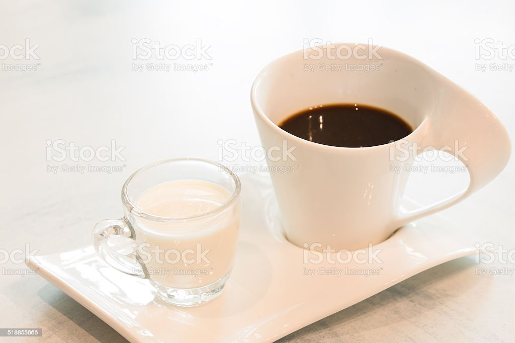 Black coffee and fresh milk on white background stock photo