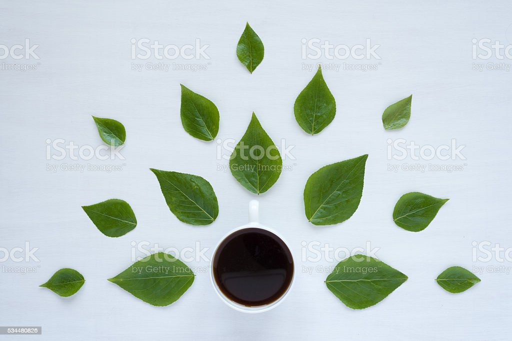 Black coffee and green leaves on white background stock photo