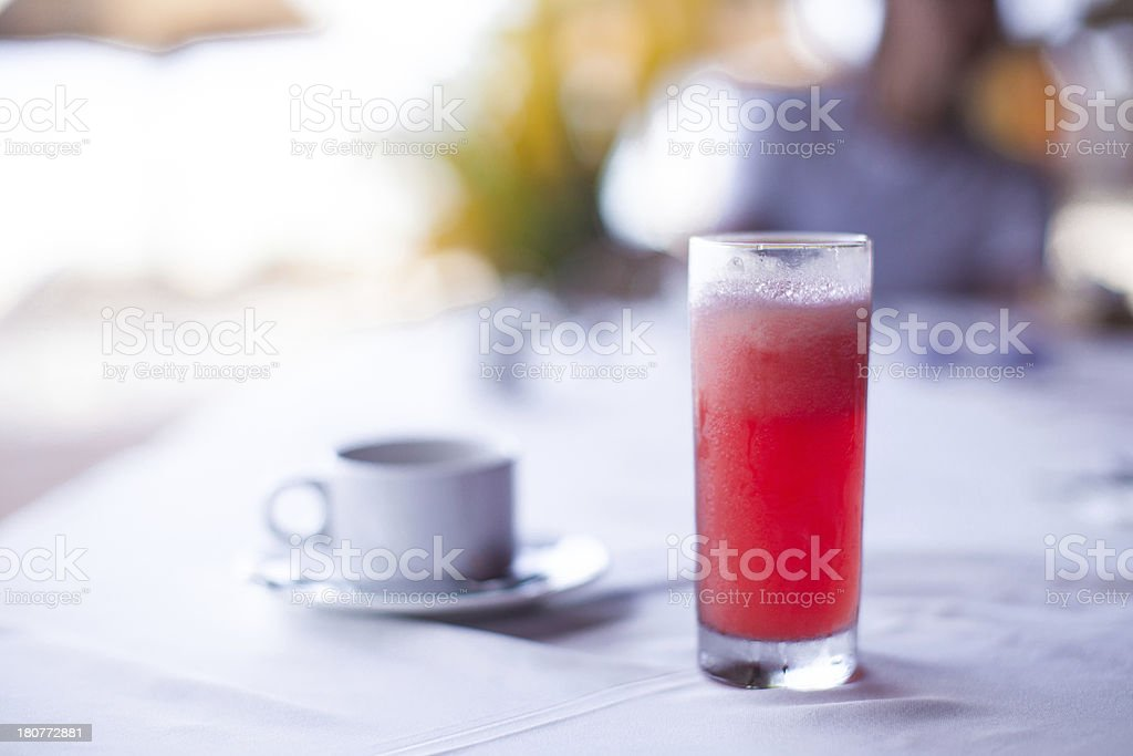 Black coffee and red waterlemon juice for breakfast at cafe stock photo