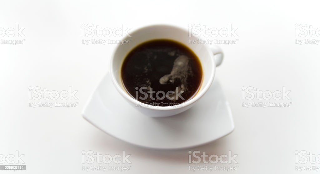 Black coffee in a white cup on a white saucer. Still-life on a white background. stock photo