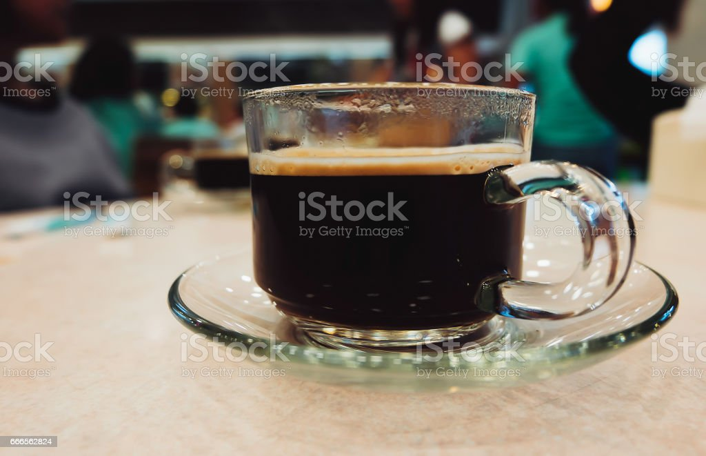 Black Coffee in Crystal Glass on Table, Cafeteria Background stock photo