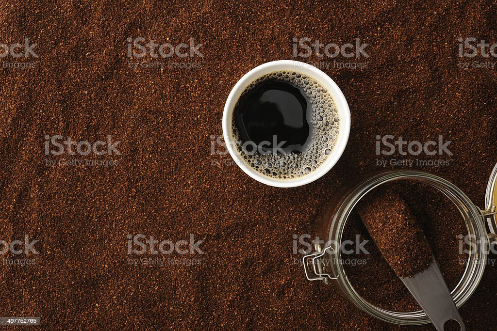 Black coffee in disposable cup on ground coffee beans royalty-free stock photo