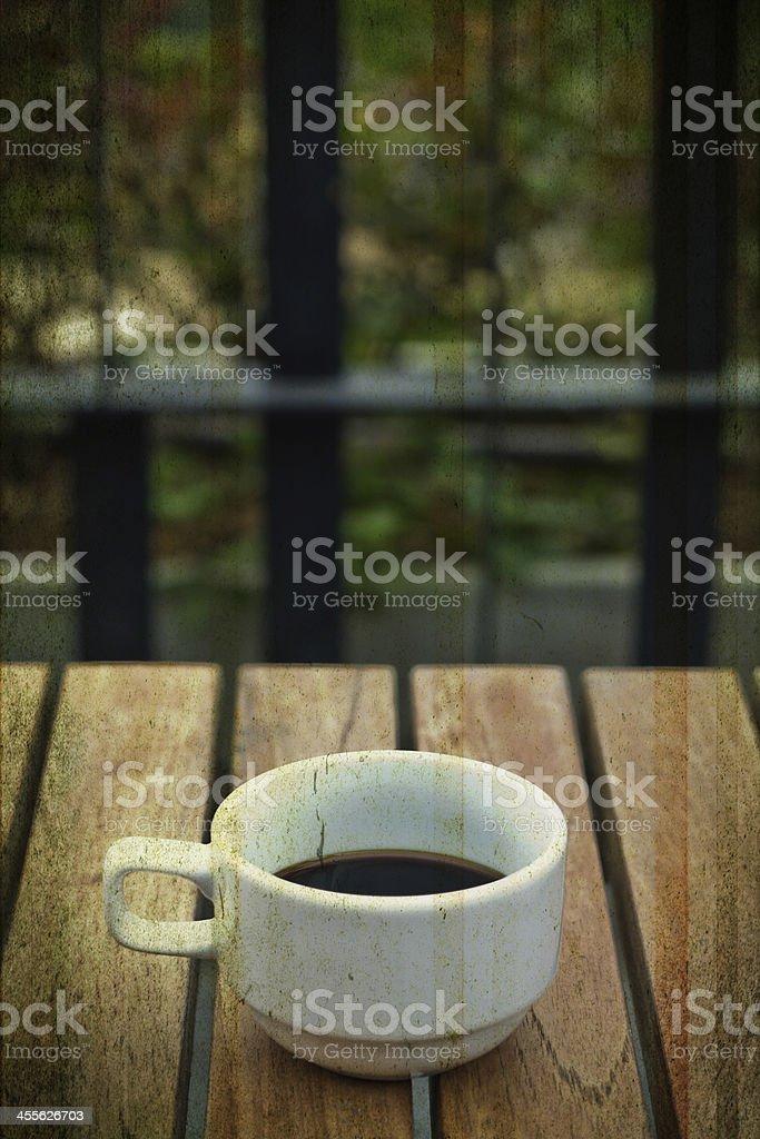 black coffee in garden,grunge style royalty-free stock photo