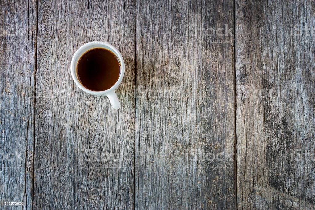 Black coffee in white Ceramic Cup on old wooden table. stock photo