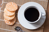 Black coffee in white cup and Crispy Rice Crackers