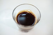 Black coffee on a white background, soft focus image.