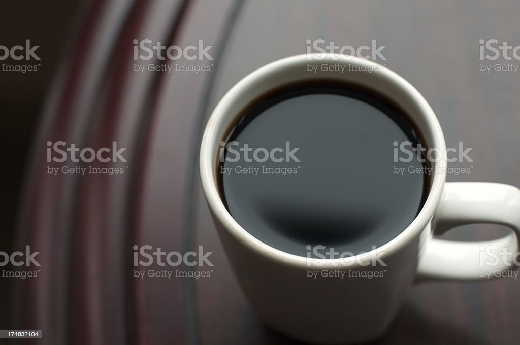 Black Coffee on a Wood Table stock photo