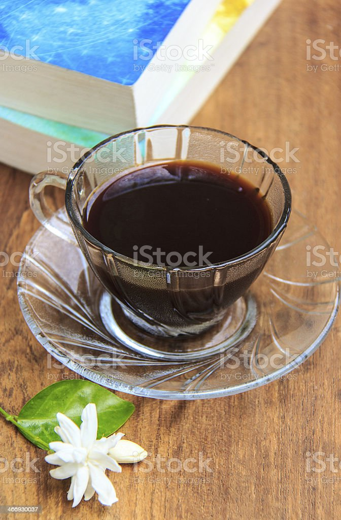 black coffee on  table with old books and Jasmine flower royalty-free stock photo