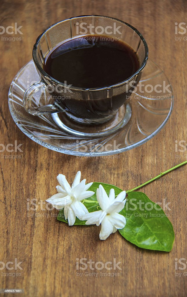 black coffee on wooden table with Jasmine flower royalty-free stock photo