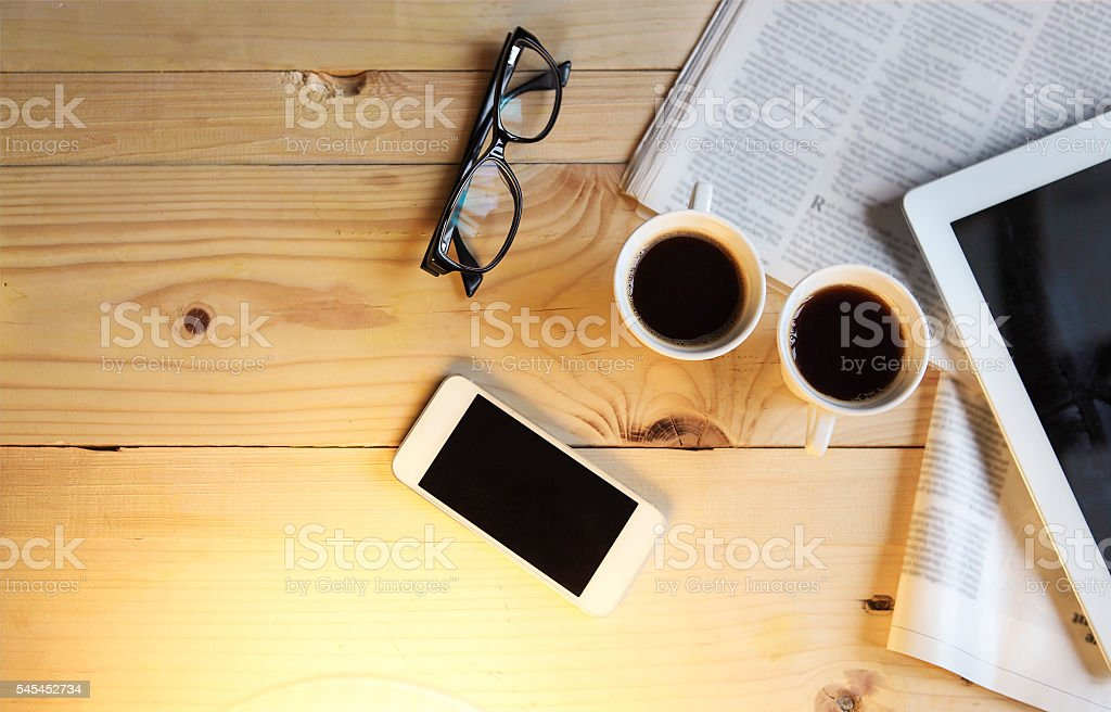 Black coffee with blank digital tablet and mobile phone, magazin stock photo
