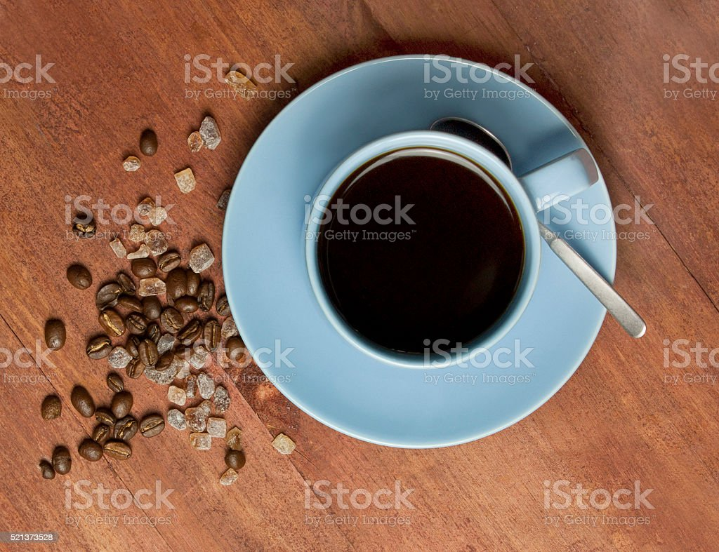 Black coffee with coffee grains and cane sugar stock photo