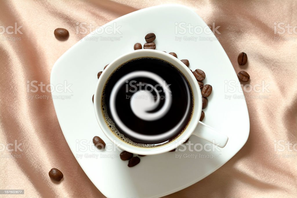 Black coffee with cream in china cup, brown satin background stock photo
