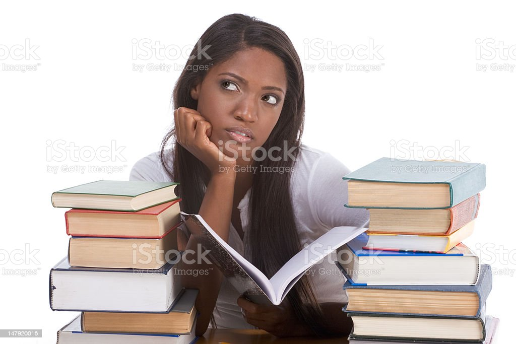 Black college student woman by stack of books royalty-free stock photo