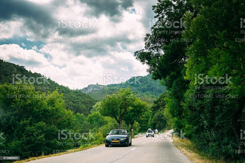 Black colour Audi car on background of French mountain nature stock photo