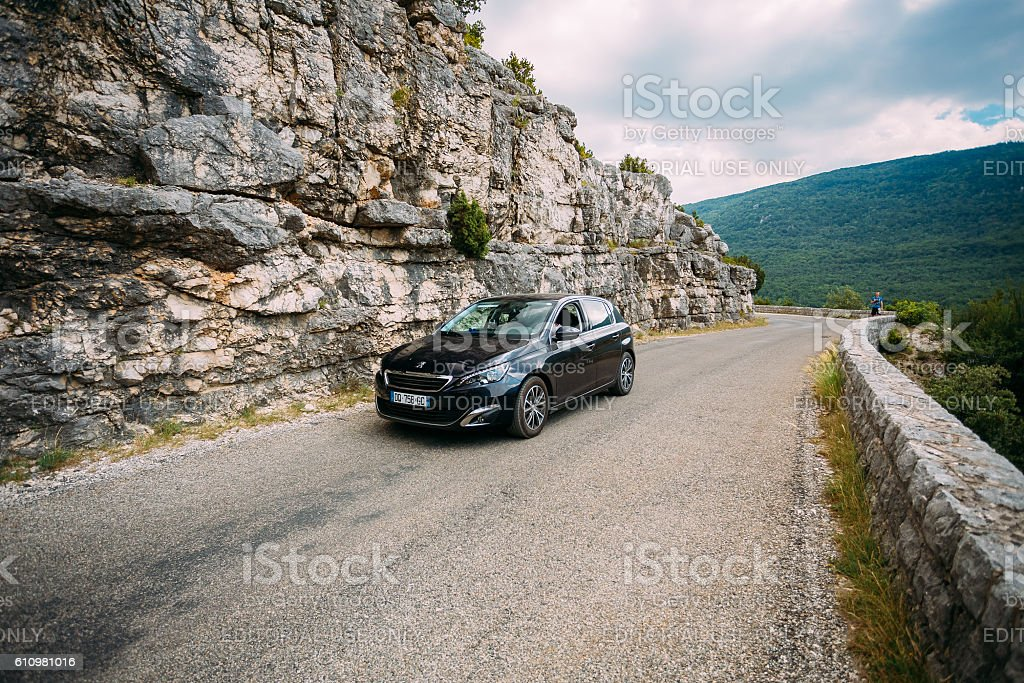 Black colour Peugeot 308 car on background of French mountain stock photo