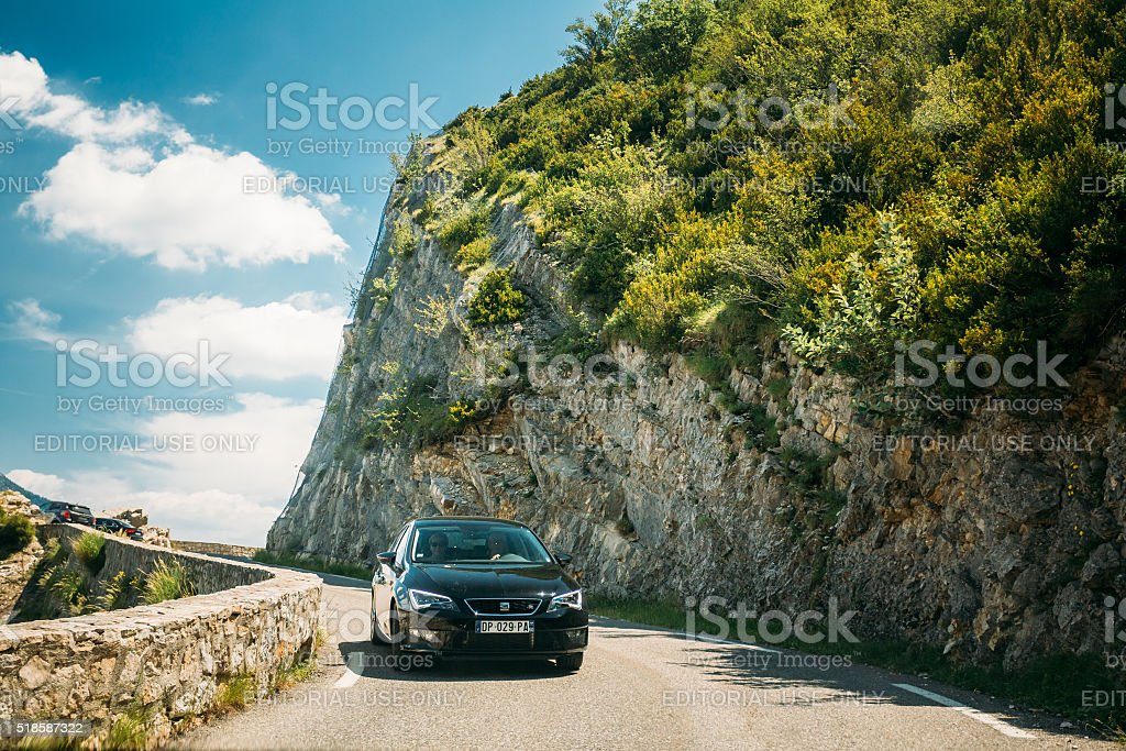Black colour Peugeot 308 car on background of French mountains stock photo