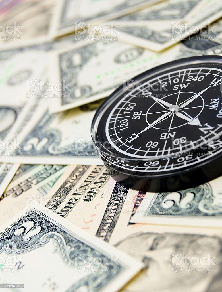 Black compass on dollars. royalty-free stock photo