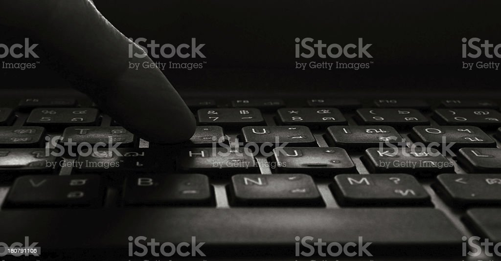 black computer keyboard with hands royalty-free stock photo