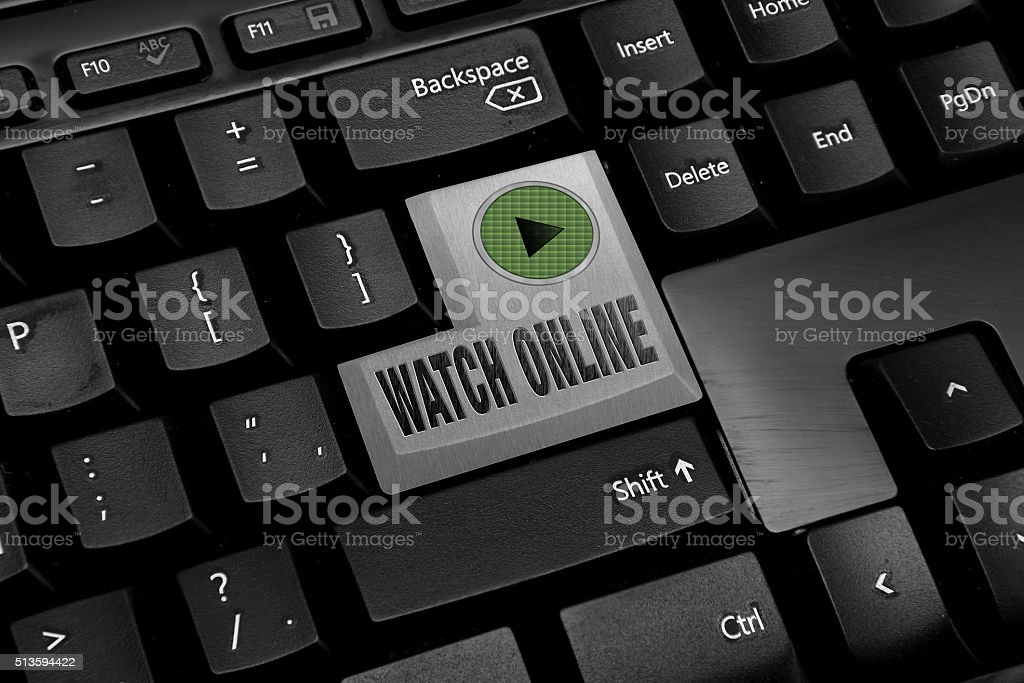 Black Computer keyboard with watch online button stock photo