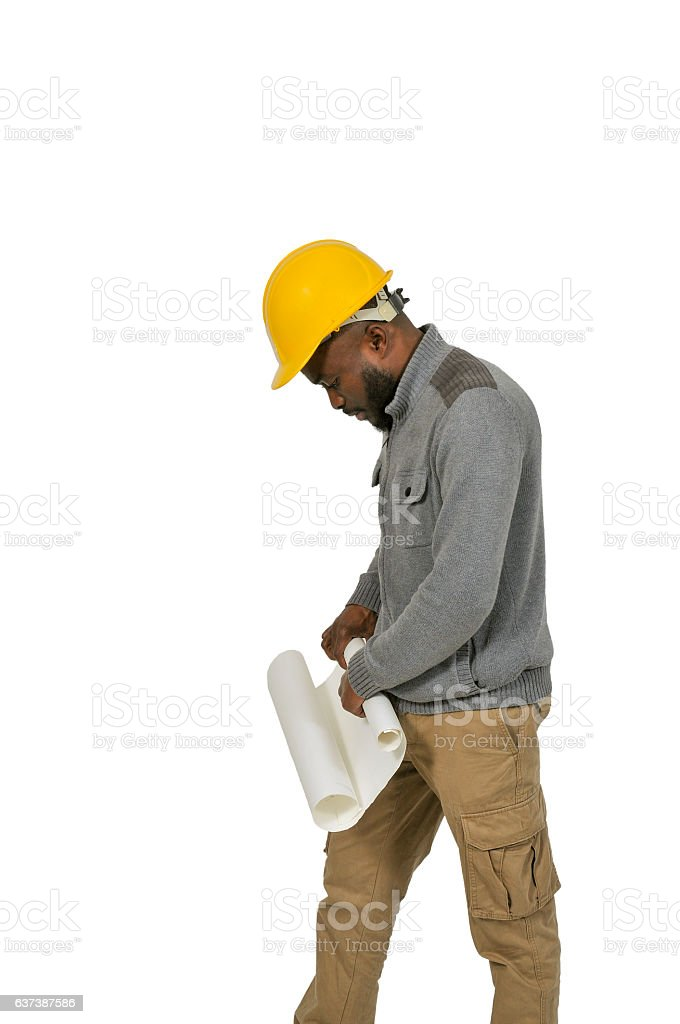 Black Construction Worker with Blueprints stock photo